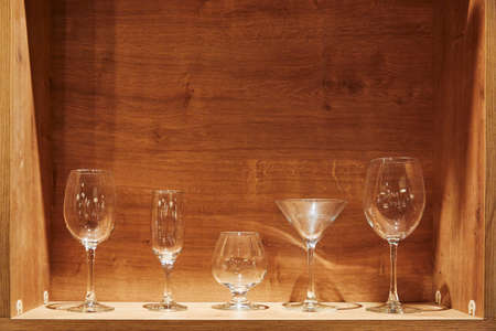 Foto de Different types of empty glasses on a wooden background - Imagen libre de derechos