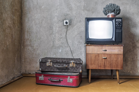 Photo for old room. retro tv and two suitcases - Royalty Free Image