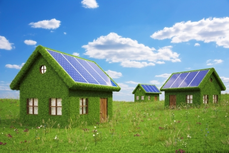 houses from the grass with solar panels on the roof.