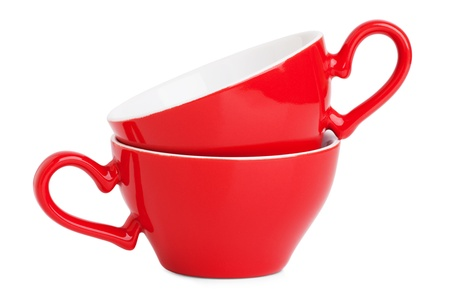Two elegant red coffee cups on a white background