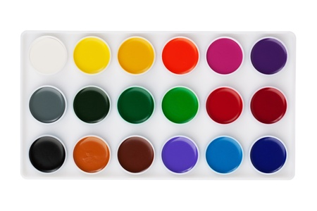 Different set of watercolors in the box on a white background