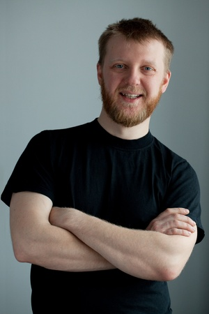 Cheerful red-bearded smiling guy in the  black t-shirt