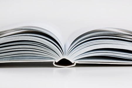 Pages open a thick book on white background