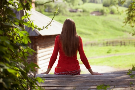 Slim long-haired girl sitting and resting