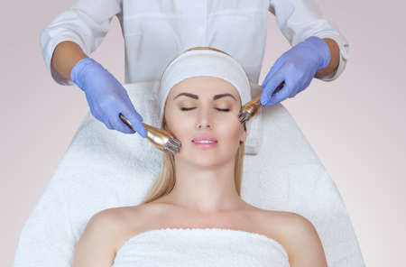Photo pour Portrait of woman getting rf-lifting. Rf lifting procedure in a beauty parlour - image libre de droit