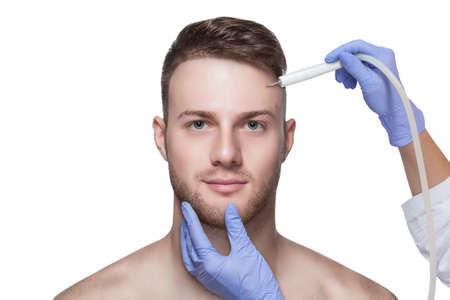 Photo for Men's cosmetology. Beautician makes a man a procedure to remove acne from his face. - Royalty Free Image
