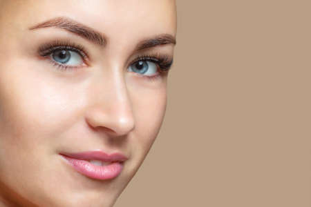 Photo for Portrait of a beautiful happy smiling woman with clean skin with blue eyes. Professional makeup and cosmetology skin care. - Royalty Free Image