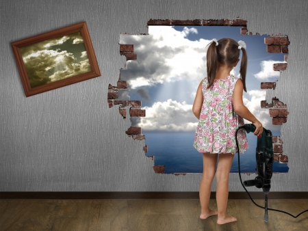 Photo for Child girl break the wall, discovery concept - Royalty Free Image