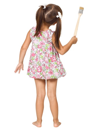 little girl with paintbrush, back view