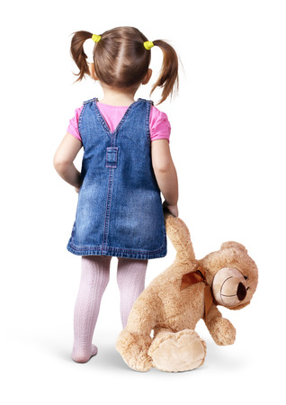 Foto de Little child girl with toy bear on white, back view - Imagen libre de derechos
