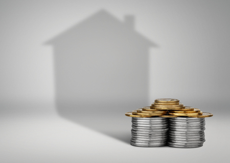 real estate loans concept, money with house shadow