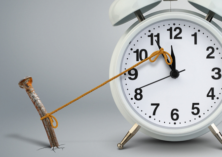 Foto de Time on clock stop by nail, delay concept - Imagen libre de derechos