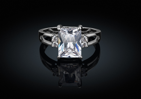 Photo for jewelry ring with big square diamond on black background with reflection - Royalty Free Image