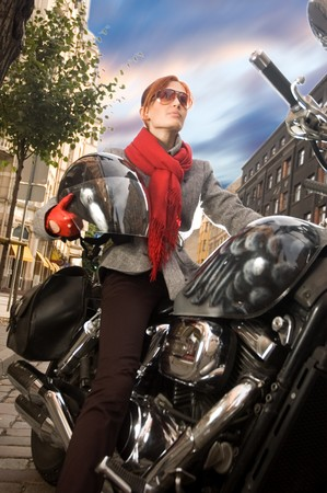 Beautiful woman on the motorcycleの写真素材