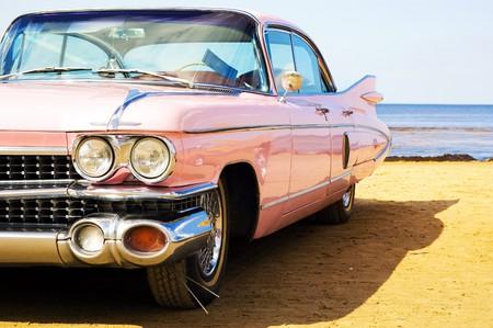 Classic pink car at beach