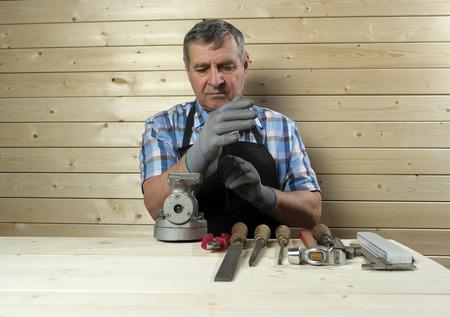 Senior carpenter working in workshop