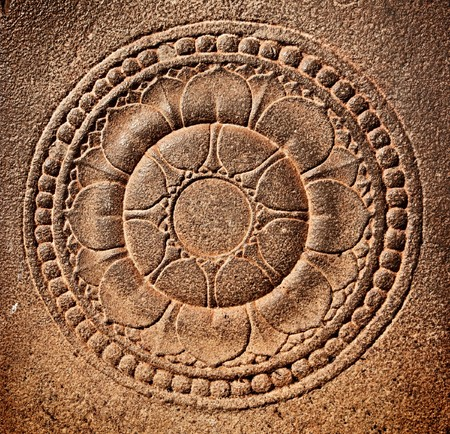 Stylized lotus carved on stone