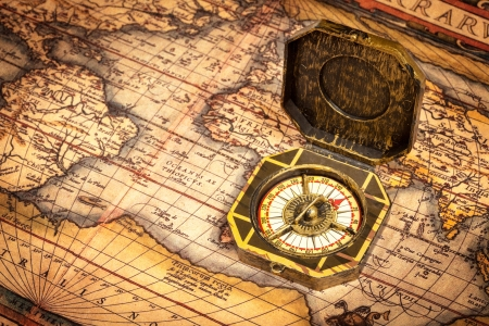 Vintage pirate retro compass on ancient world map