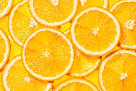 Photo pour Colorful orange citrus fruit slices background backlit - image libre de droit