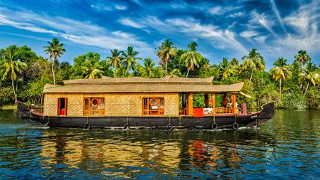 Photo pour Travel tourism Kerala background - panorama of tourist houseboat on Kerala backwaters. Kerala, India - image libre de droit