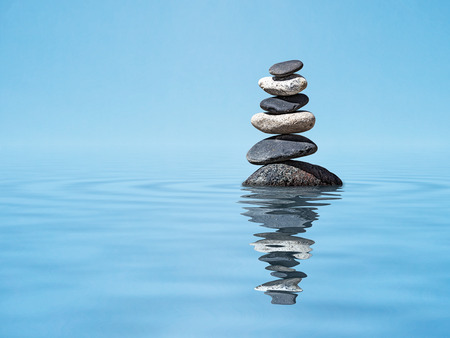 Photo pour Zen harmony meditation relaxation peacefulness peace of mind concept background -  balanced stones stack in water with reflection - image libre de droit
