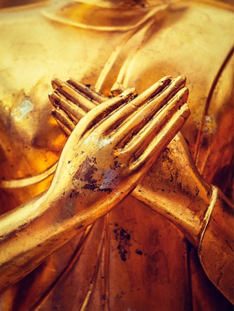 Vintage retro effect filtered hipster style image of gold Buddha statue hands close up in Wat Phra That Doi Suthep, Chiang Mai, Thailand