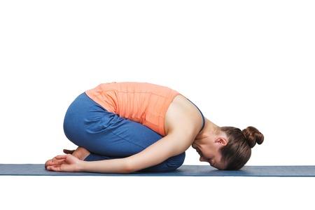 Photo pour Beautiful sporty fit yogini woman practices yoga asana balasana (child's pose) - resting pose or counter asana for many asanas in studio isolated on white - image libre de droit