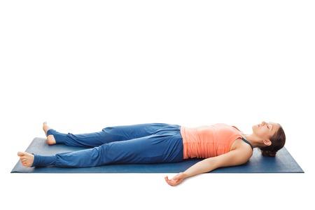 Photo pour Woman relaxes in yoga asana Savasana - corpse pose isolated on white - image libre de droit