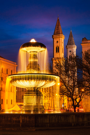 Fountain in the Geschwister-Scholl-Platz and St. Ludwigs Church