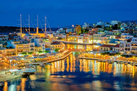 Photo for Beautiful Agios Nikolaos town at night. Lasithi region of Crete island, Greece - Royalty Free Image