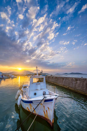 Photo for Fishing boat in port of Naousa on sunset. Paros lsland, Greece - Royalty Free Image