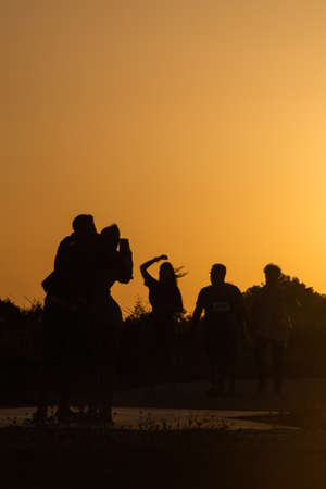 backlighting of people having fun at sunset
