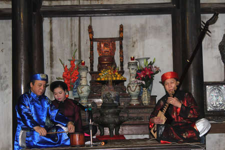 HAI DUONG, VIETNAM, March 28: folk artists singing folk songs at festival on March, 28, 2014 in Hai Duong, Vietnam.