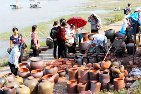 HAI DUONG, VIETNAM, AUGUST, 12: people at the ceramics market on