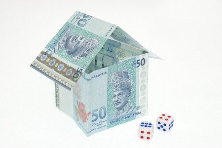 Malaysia Money House with Dice Conceptual Financial Uncertainty