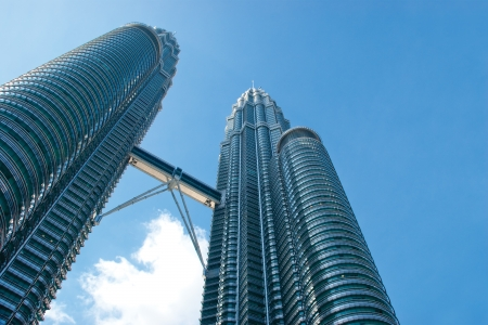 Photo for KUALA LUMPUR - MAY 28 : The Petronas Twin Towers (KLCC) on May 28, 2011, in Kuala Lumpur, Malaysia are the most famous landmark of Malaysia tourism as its framed for Islamic-inspired modern architecture. - Royalty Free Image