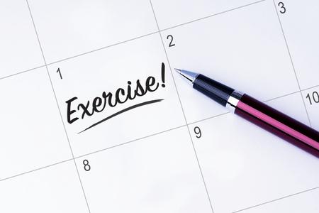 The words Exercise written on a calendar