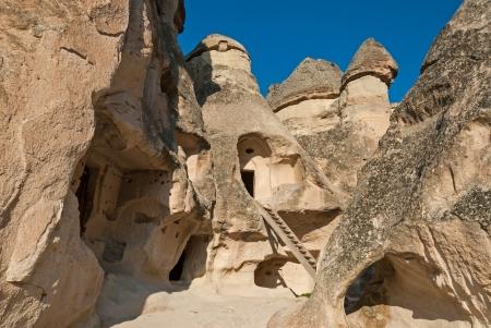 Hoodoos  or fairy chimneys  hollowed out for dwellings in Cappadocia, Turkey