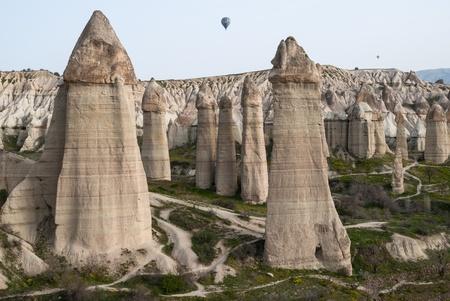 Typical landscape with hoodoos  or fairy chimneys  in Cappadocia, Turkey