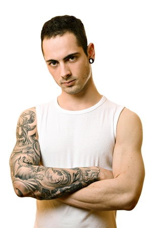Handsome young man with tattoo, isolated on white