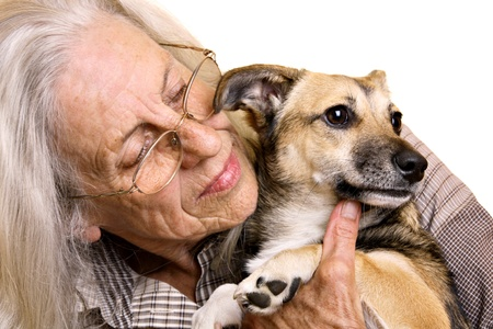 Senior woman with cute mixed breed puppy