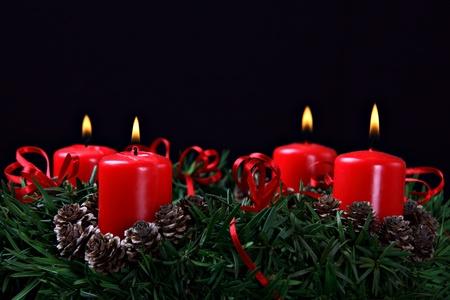 Advent wreath against black background