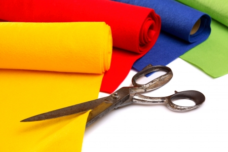 Different felt rolls with big scissors