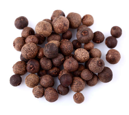 Dried allspice on a white background