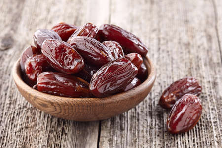 Photo for Dates fruit on a wooden background - Royalty Free Image
