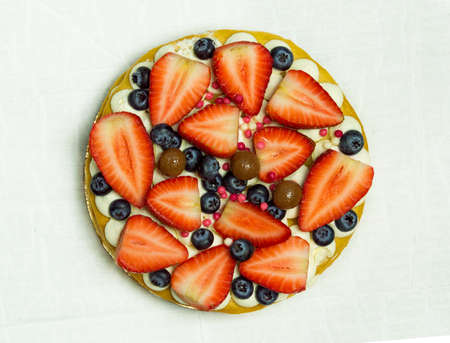 Photo for Delicious tart with fresh strawberries, raspberries and currants on the table. top view horizontal - Royalty Free Image