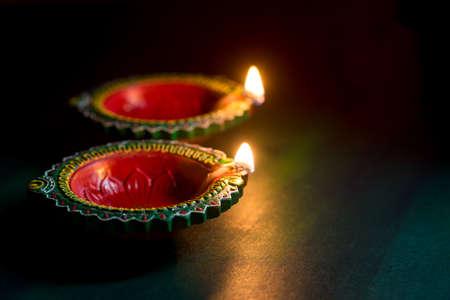 Photo for Happy Diwali - Clay Diya lamps lit during Diwali celebration. Greetings Card Design of Indian Hindu Light Festival called Diwali - Royalty Free Image