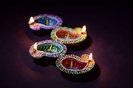 Photo pour Colorful clay Diya (Lantern) lamps lit during Diwali celebration. Greetings Card Design Indian Hindu Light Festival called Diwali. - image libre de droit