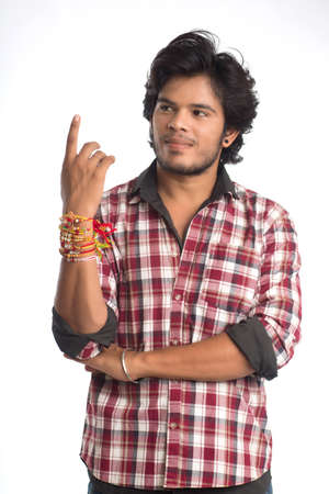 Photo for Young men showing rakhi on his hand on an occasion of Raksha Bandhan festival. - Royalty Free Image