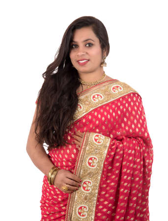 Photo for Beautiful young girl posing in Indian traditional saree on white background. - Royalty Free Image